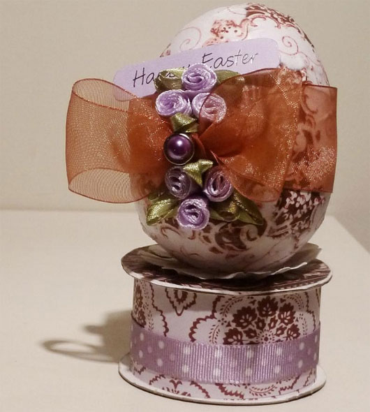 Paper covered egg decoration
