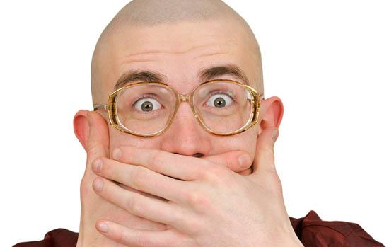 Man holding back vulgar jokes