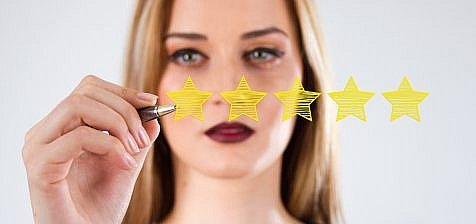 Review, increase rating or ranking, evaluation and classification concept. Businessman draw five yellow star to increase rating of his company