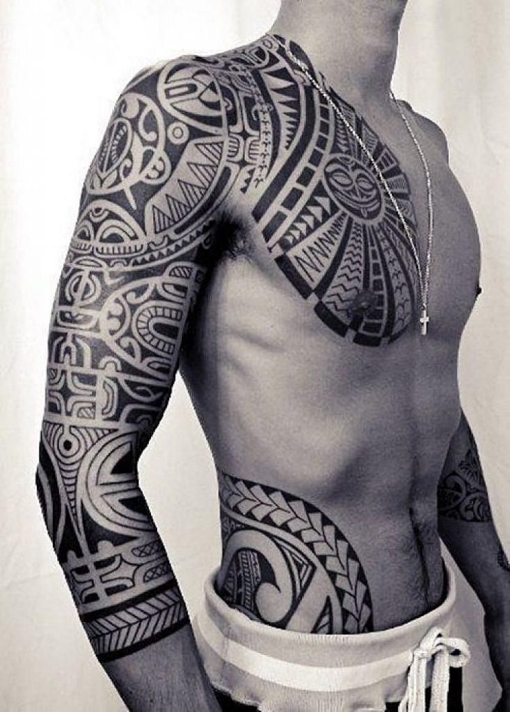traditional polynesian tattoo tiki mask pectoral tattoo