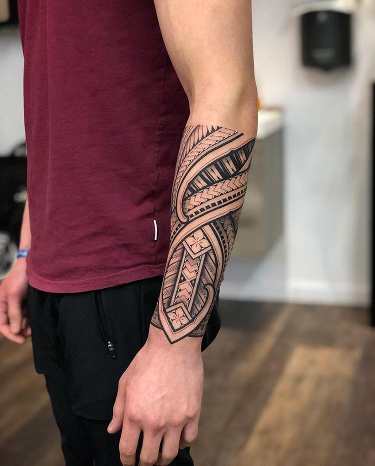 traditional polynesian tattoo modern lower arm tattoo