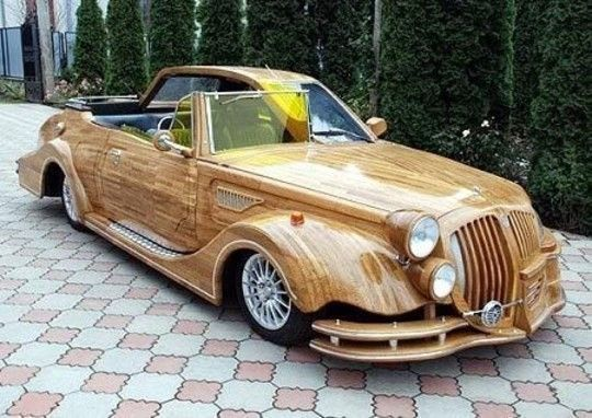 Image: Two-faced wooden car